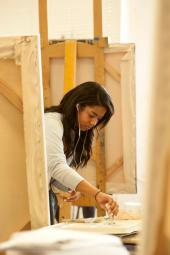 Art studio and psychology major, works on her piece during the Intermediate Painting class in the Art Building
