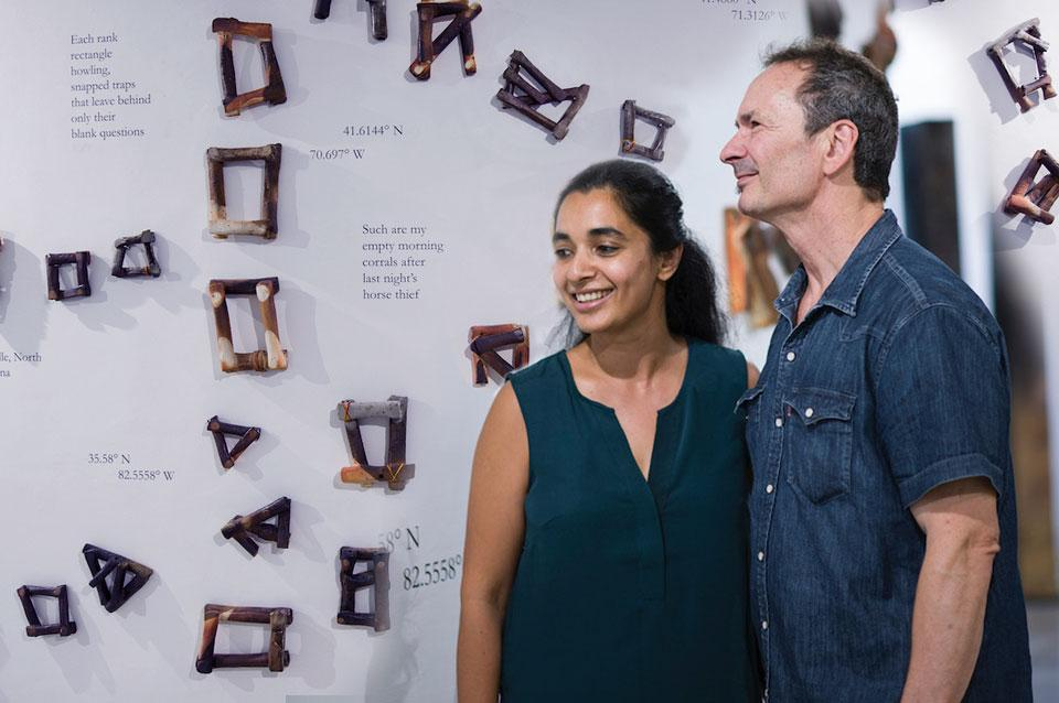 Ashwini Bhat and Forrest Gander pose next to their art installation.