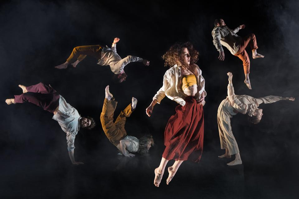 Six acrobats are posed in unique ways.
