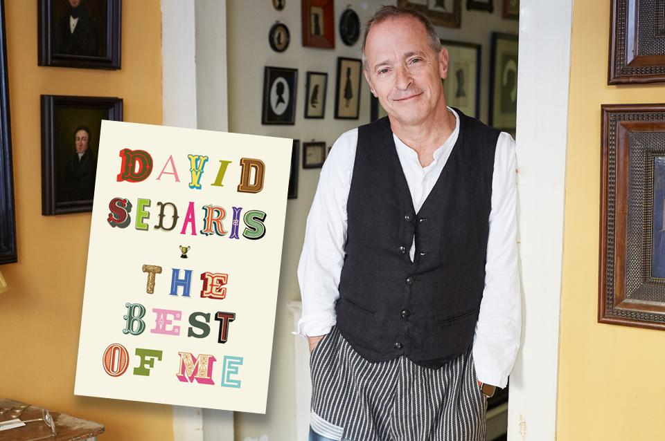 David Sedaris leans against a doorway with his hands in his pockets. His book cover featured next to him.