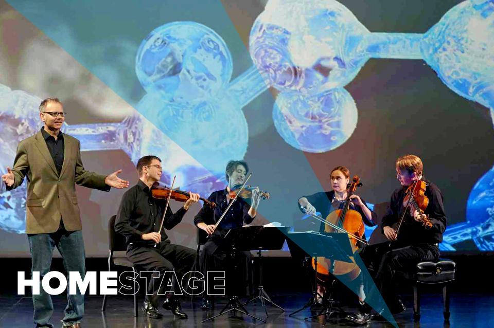 The members of the Fry Street Quartet are seated in a semi-circle and the backdrop shows a colorful array of fish on a reef.