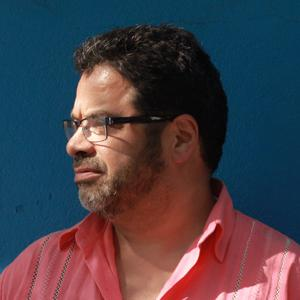 Arturo O'Farrill looking to the side.