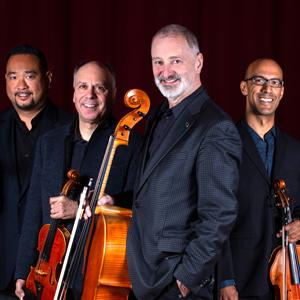 The members of Alexander String Quartet pose with their instruments.