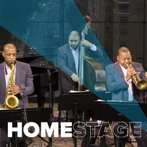 Members of Jazz at Lincoln Center Orchestra Septet with Wynton Marsalis playing on stage.