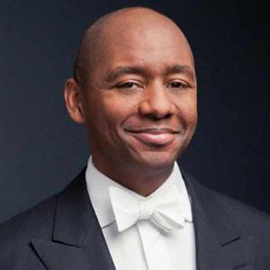 Portrait of smiling Branford Marsalis wearing a white tie tuxedo