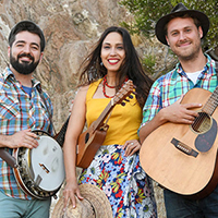 A smiling Sonia De Los Santos and The Okee Dokee Brothers with their banjo, guitar and ukulele